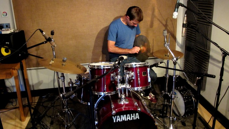 Niall setting up for the drum recording. Dynamic microphones were used close-mic the snare and kick drum. A mixture of large- and small-diaphragm condenser microphones were used elsewhere, placed further away from the drum kit.