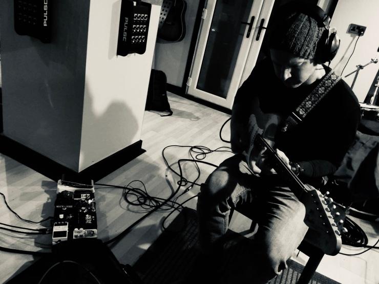 Matt recording with his 1967 replica Fender Stratocaster electric guitar