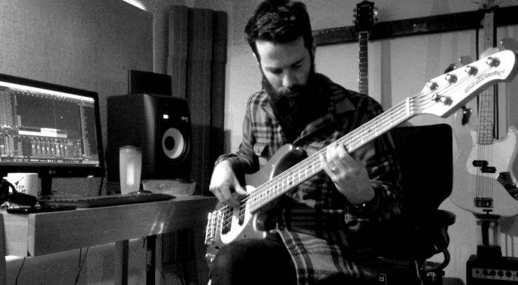 Alex recording the bass part to Chasing Butterflies using his Music Man Sterling 5-string bass guitar